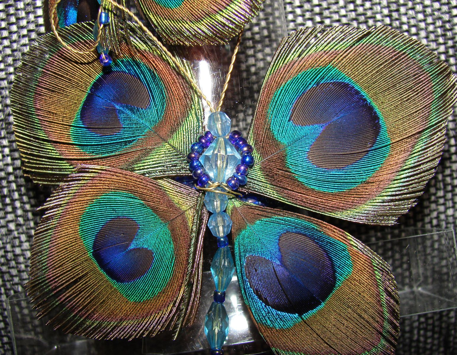 Butterfly Napkin ring made from Peacock feathers